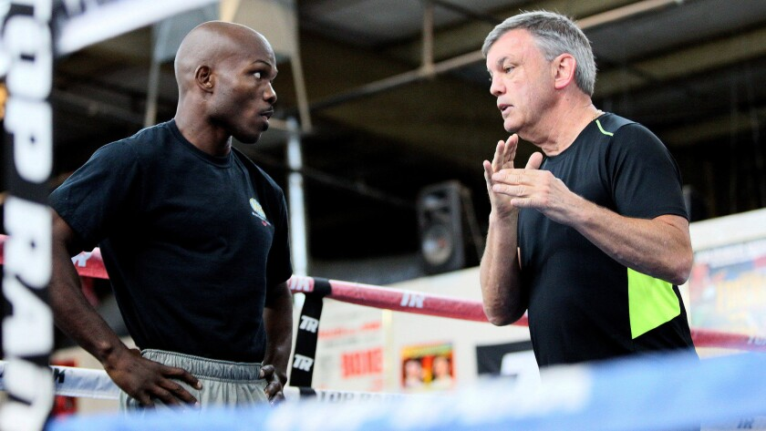 Timothy Bradley Jr. gets some instruction from trainer Teddy Atlas during a recent workout.