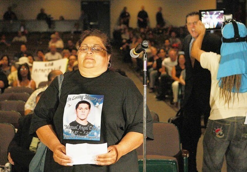 """An irate man shouts insults at Genevieve Huizar, the mother of Manuel Angel Diaz, who was killed by Anaheim police. Before the outburst, she told the council: """"I want young children to have hope, have peace."""""""