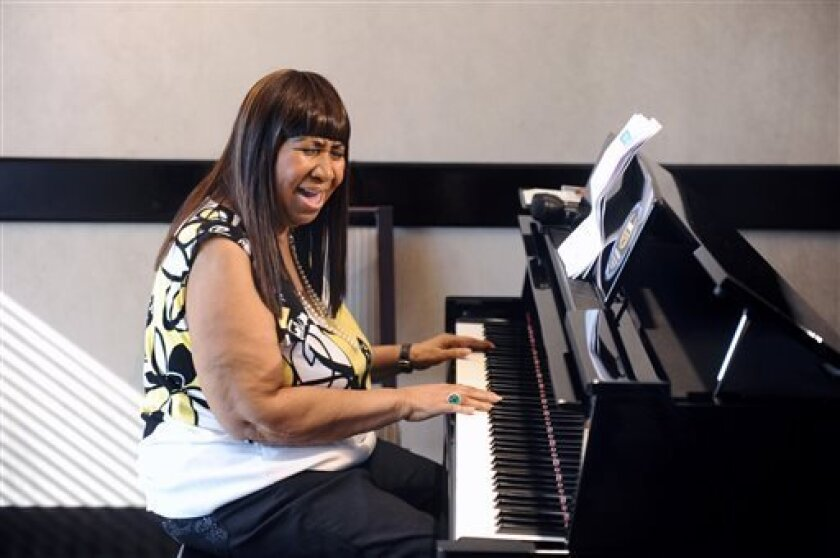 Aretha Franklin announced the pre-production of her new album as she played a few songs for the media at the Southfield Westin Hotel, Wednesday, Oct. 16, 2013, in Southfield, Mich. (AP Photo/Detroit News, Max Ortiz)