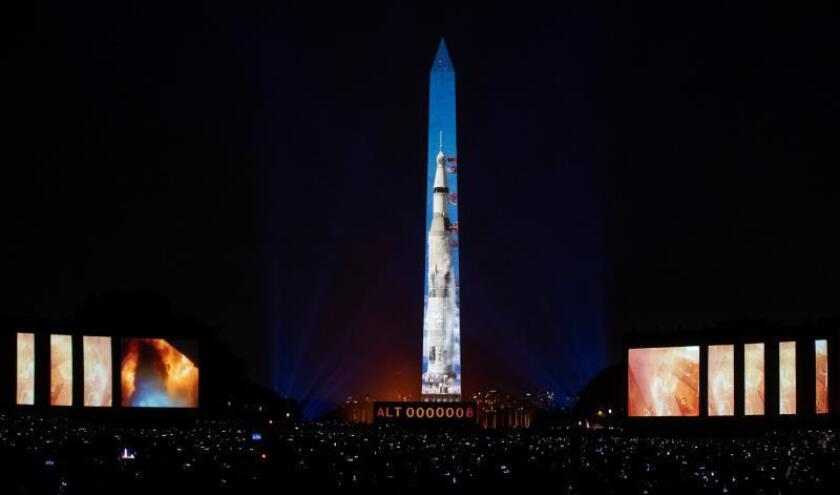 The launch of the Apollo 11 Saturn IV rocket is projected onto the Washington Monument and additional screens on the National Mall by in Washington, DC, USA, 19 July 2019. EFE/EPA/Erik S. Lesser