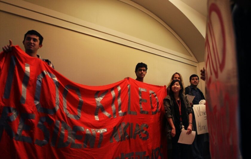 In November, members of USC's Student Coalition Against Labor Exploitation waited outside President C.L. Max Nikias' office to deliver a letter demanding that brands producing university apparel in Bangladesh sign a contract that guaranteed better treatment for factory workers.