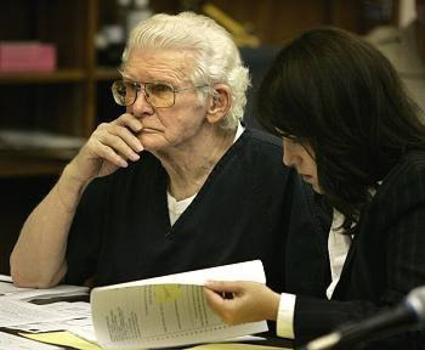 Sex offender John Norman, 81, with his public defender, Marion Gaston, listens during his hearing Wednesday in San Diego Superior Court. Norman was returned to state hospital for violating several rules of his release.