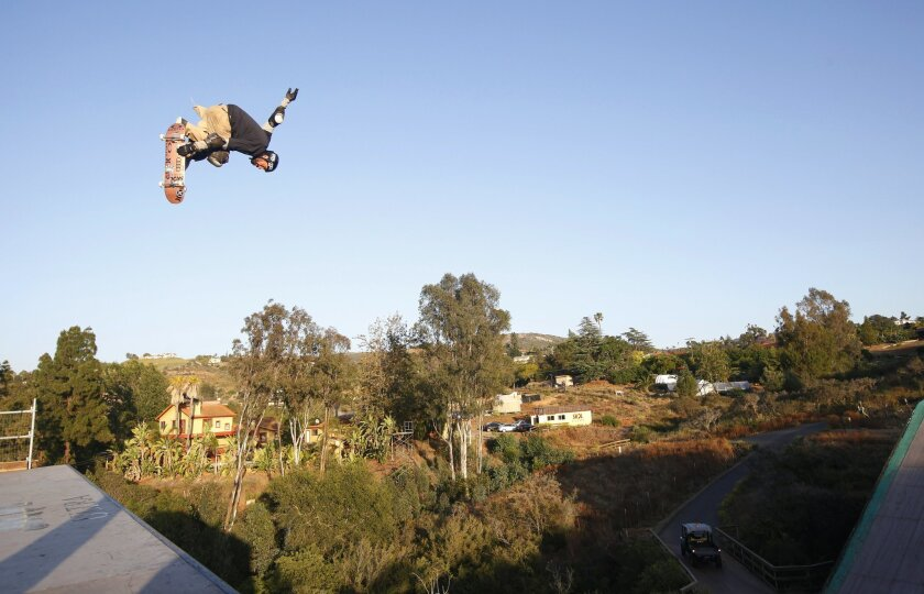 Professional skateboarder Bob Burnquist does an aerial on the 30 foot tall quarter pipe section of his megaramp at his Vista home as he prepares for the X-Games.