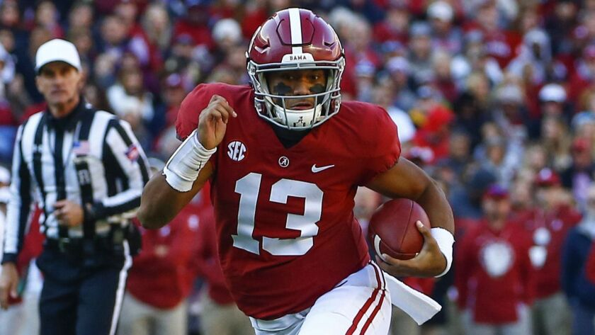 Alabama quarterback Tua Tagovailoa carries the ball against Mississippi State in November 2018.