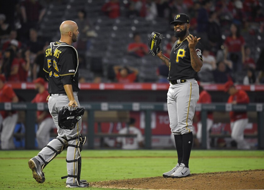 Pittsburgh Pirates closer pitcher Felipe Vazquez, right, gestures to catcher Jacob Stallings after defeating the Angels on Monday.