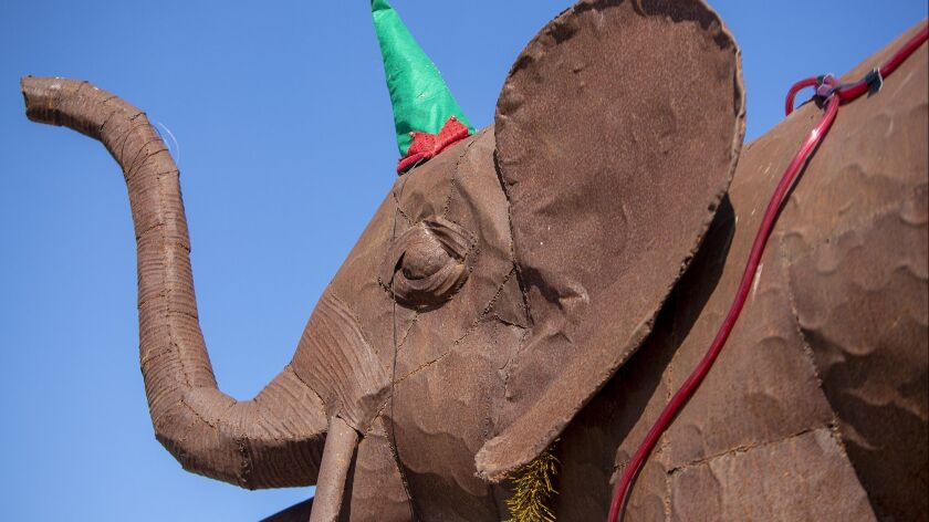 """A pair of giraffe's and an elephant are part of the decorations for Greg Killingsworth's boat """"Parad"""