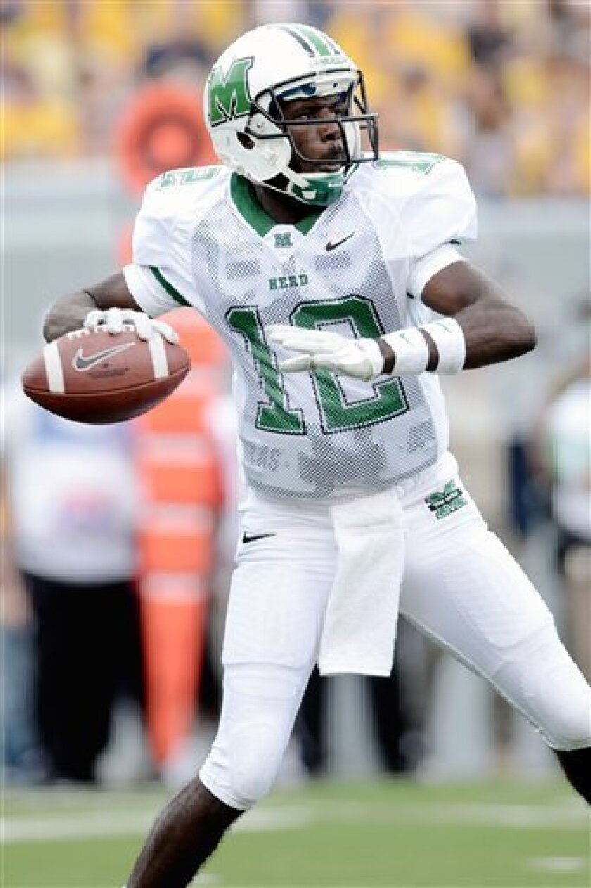 Marshall's Rakeem Cato drops back to pass against West Virginia during the first quarter of an NCAA college football game, Sunday, Sept. 4, 2011, in Morgantown, W.Va. (AP Photo/Jeff Gentner)