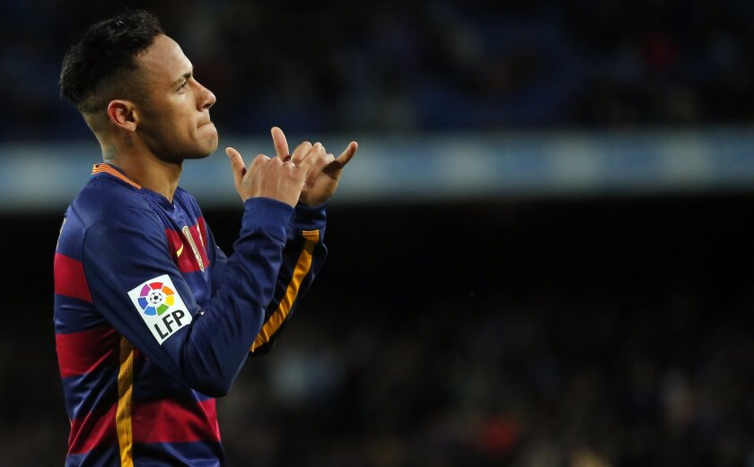 FC Barcelona's Neymar reacts after scoring against Celta Vigo during a Spanish La Liga soccer match at the Camp Nou stadium in Barcelona, Spain, Sunday, Feb. 14, 2016. (AP Photo/Manu Fernandez)