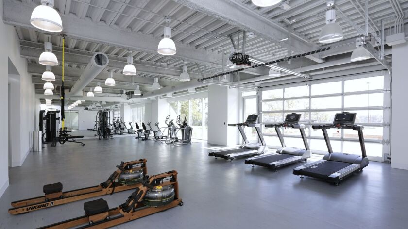 Part of the ground floor was converted to a gym for building tenants.