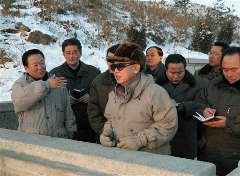 In this undated photo released by Korean Central News Agency via Korea News Service in Tokyo Thursday, Jan. 7, 2010, North Korean leader Kim Jong Il, center, inspects the construction site of Ryesonggang Youth Power Station No. 2 in North Hwanghae Province, North Korea. (AP Photo/Korean Central News Agency via Korea News Service)
