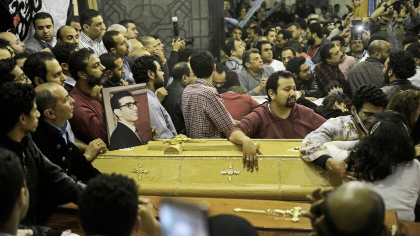 Relatives of the bomb victims grieve as coffins are taken into St. George's Church in Tanta, Egypt.