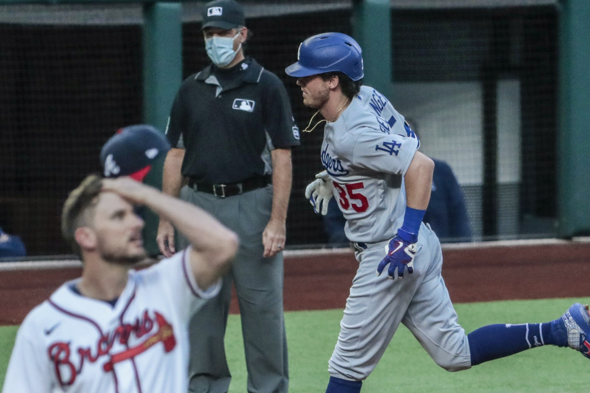 Dodgers center fielder Cody Bellinger circles the bases after hitting a home run off Braves relief pitcher Grant Dayton