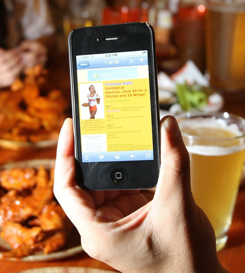 A recent mobile deal from the Hooters Restaurant in Rancho Bernardo included a pitcher of beer and wings. The deal pops up on the consumer's cell phone.