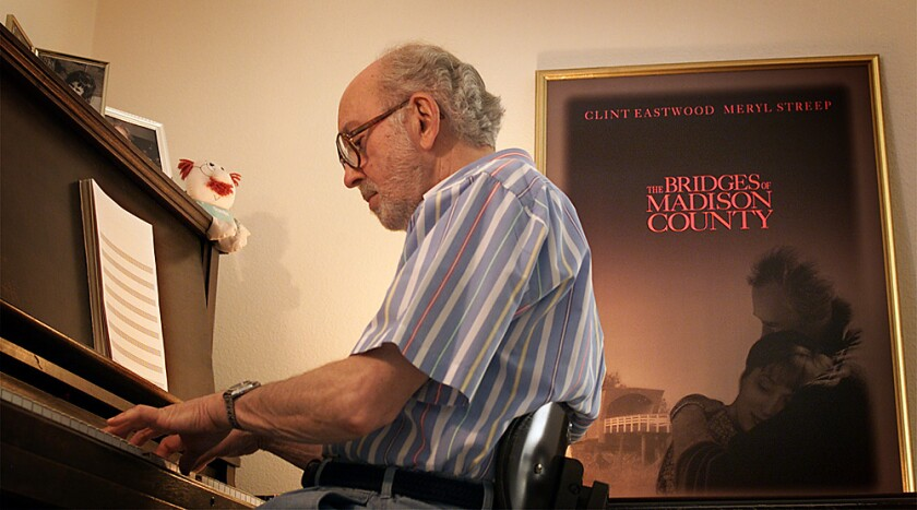 "Lennie Niehaus at his piano with ""The Bridges of Madison County"" poster on the wall at his home in Thousand Oaks in 2000."