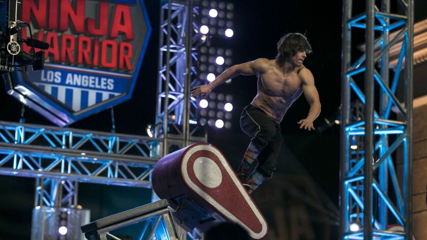"""Athletes and even journalists tackle the labyrinthine """"American Ninja Warrior"""" obstacle course in a"""
