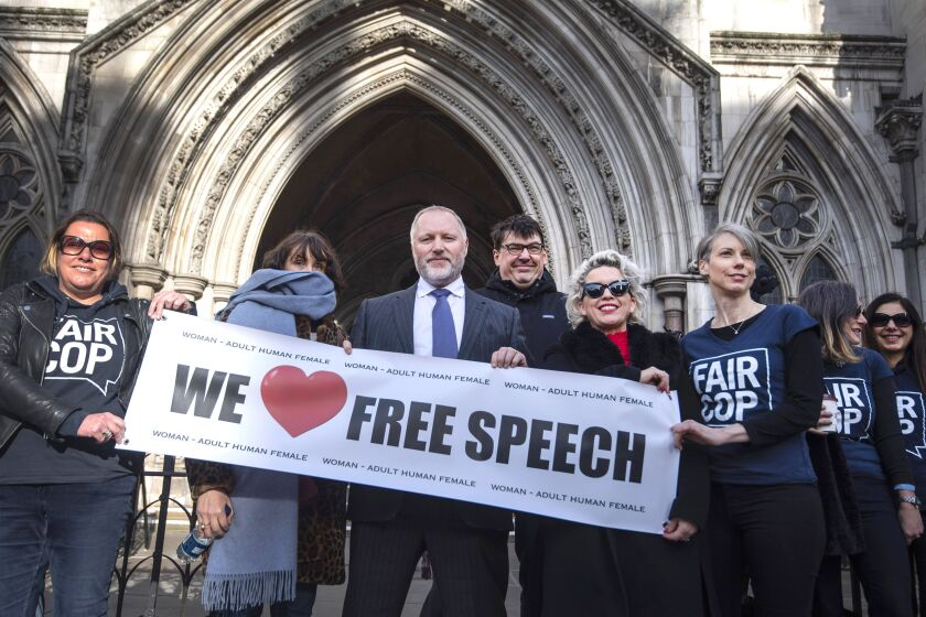 "Former police officer Harry Miller arrives outside the High Court, London, Friday, Feb. 14, 2020. A British court ruled Friday that police infringed a man's right to free expression when they showed up at his workplace to quiz him about his Twitter posts about transgender people. Humberside Police in northeast England investigated Harry Miller in January 2019 after receiving a complaint about allegedly ""transphobic"" tweets, including a limerick mocking the idea that transgender women are biologically women. (Victoria Jones/PA via AP)"