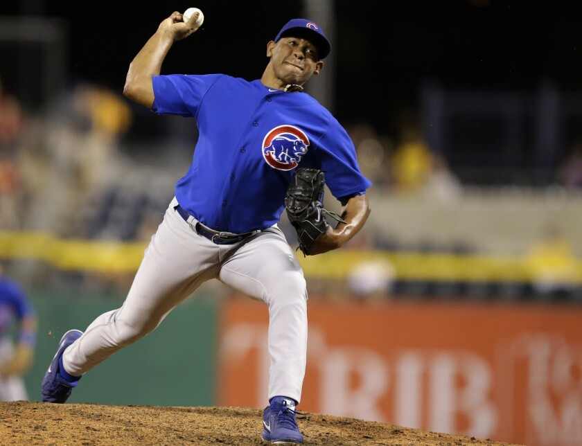 The Dodgers received closer Carlos Marmol, cash and cap space from the Chicago Cubs in exchange for Matt Guerrier.