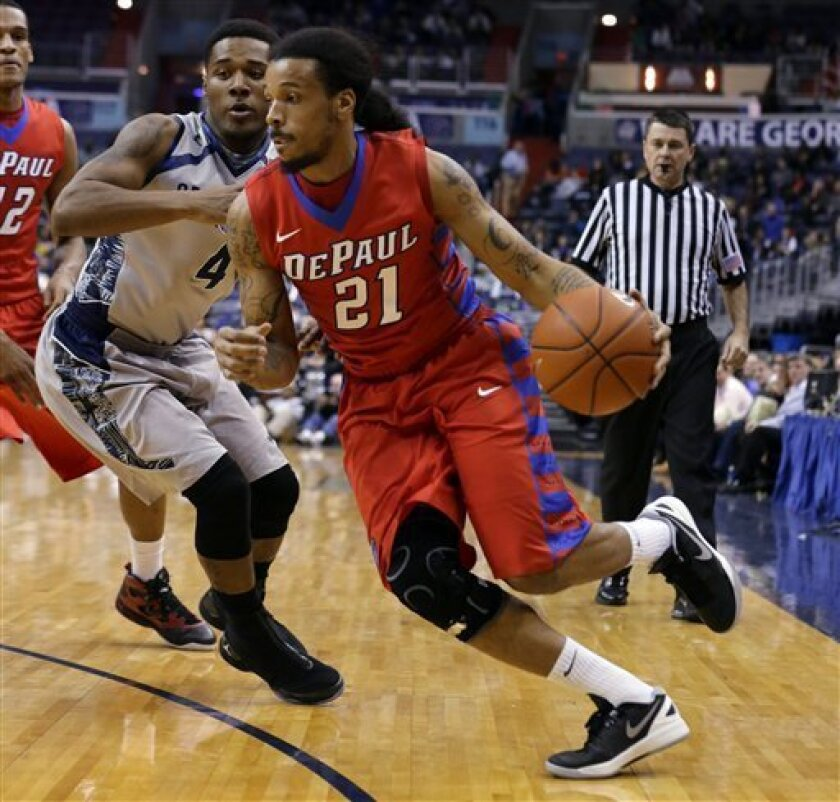 DePaul's Jamee Crockett (21) drives past Georgetown guard D'Vauntes Smith-Rivera (4) during the first half of an NCAA college basketball game, Wednesday, Feb. 20, 2013, in Washington. (AP Photo/Alex Brandon)