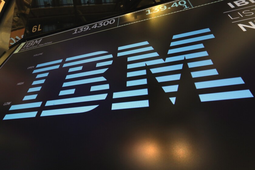 The IBM logo appears above a trading post on the floor of the New York Stock Exchange.