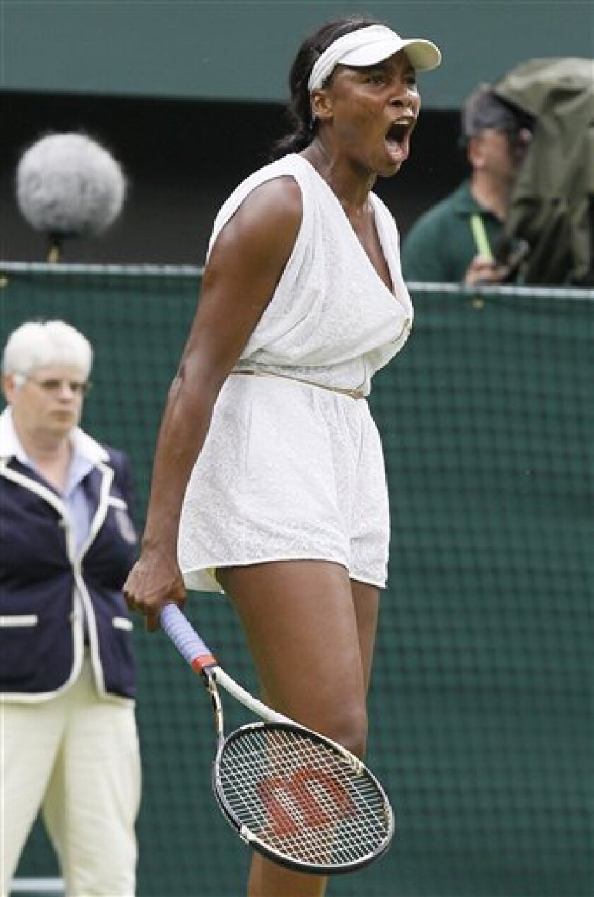 Venus Williams of the US reacts during the match against Japan's Kimiko Date-Krumm at the All England Lawn Tennis Championships at Wimbledon, Wednesday, June 22, 2011. (AP Photo/Kirsty Wigglesworth)