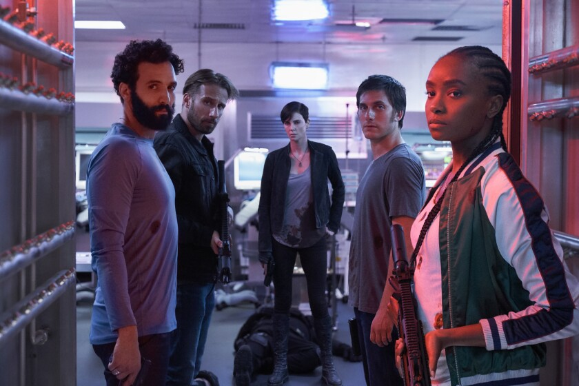 "Marwan Kenzari, left, Matthias Schoenaerts, Charlize Theron, Luca Marinelli and Kiki Layne in ""The Old Guard."""