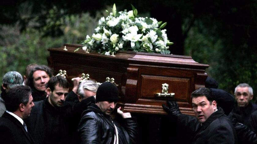The coffin of former Russian spy Alexander Litvinenko is carried during his funeral in London in 2006. Two Russian agents are the only suspects in his poisoning death. Litvinenko was an enemy of the Putin regime.