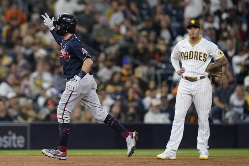The Braves' Dansby Swanson, the Padres' Manny Machado