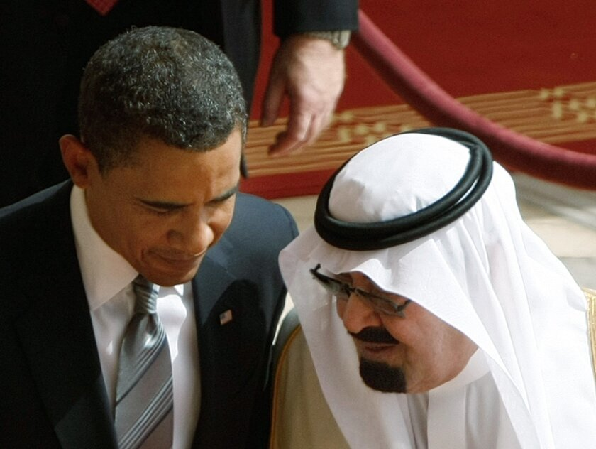 FILE - In this Wednesday, June 3, 2009 file photo, King Abdullah of Saudi Arabia, right, speaks with U.S. President Barack Obama, during arrival ceremonies at the Royal Terminal of King Khalid International Airport in Riyadh, Saudi Arabia. On early Friday, Jan. 23, 2015, Saudi state TV reported Kin