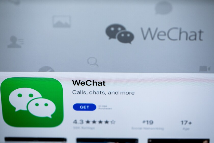 Photographs of an iPad screen showing the messaging application WeChat, owned by China's Tencent.