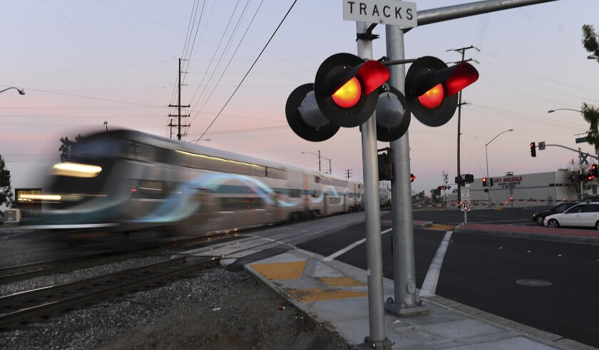 A Metrolink train crosses the intersection of Rosecrans Avenue and Marquardt Avenue in Santa Fe Springs.