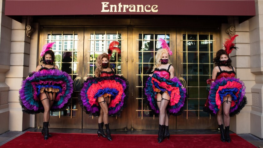 Cancan dancers welcome visitors back to Paris Las Vegas.