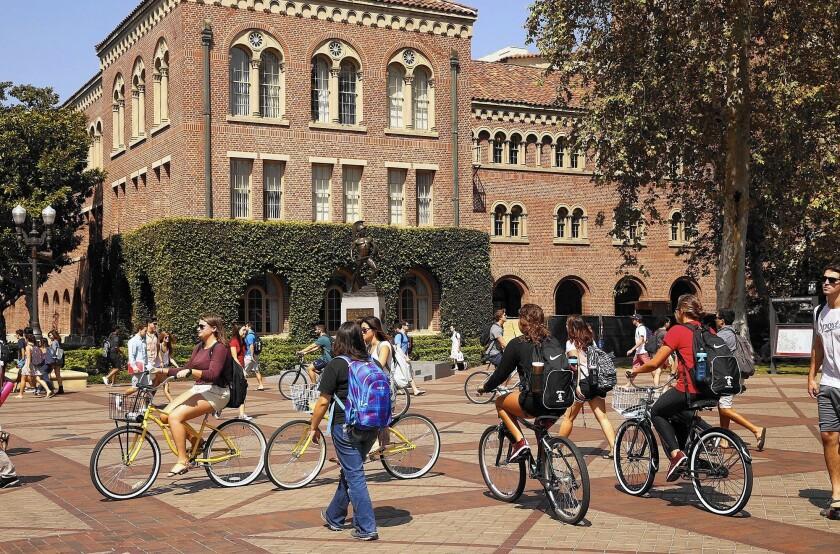 Students at the campus of USC head to classes.