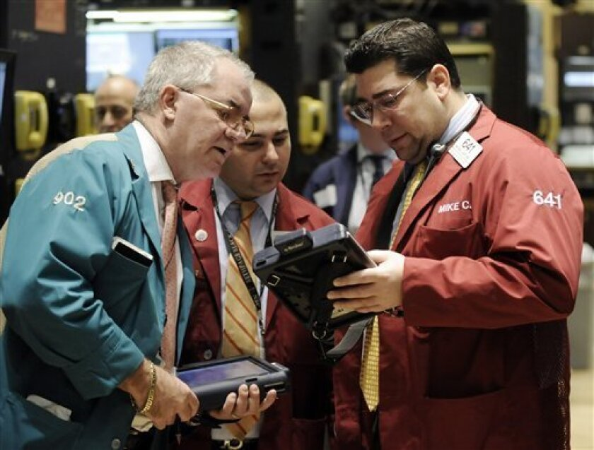 Traders confer on the floor of the New York Stock Exchange Thursday, Jan. 8, 2009 (AP Photo/Richard Drew)