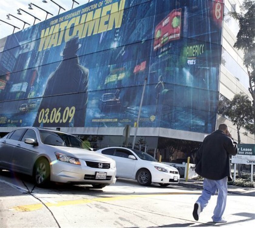 """A large movie billboard in Los Angeles. Supergraphics and digital signs are among the new generation of public ads infuriating critics across the country who say the """"billboard blight"""" distracts drivers, hurts the look of streets and could hinder access by rescue crews. (AP Photo/Matt Sayles)"""