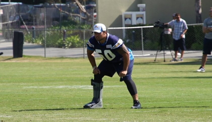Manti Te'o watches practice after injuring his foot in the Chargers first preseason game against the Seahawks.