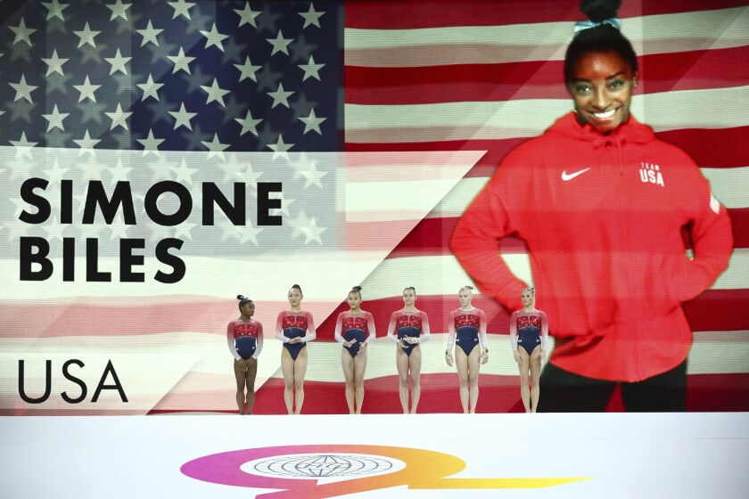 Team U.S.A. greets spectators during the official presentation ahead of the women's team final at the Gymnastics World Championships in Stuttgart, Germany, Tuesday, Oct. 8, 2019. (AP Photo/Matthias Schrader)