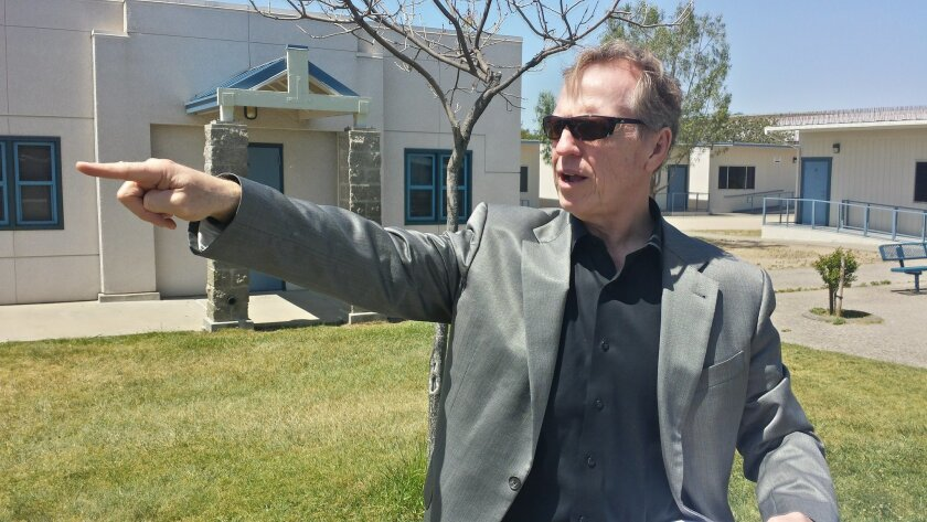 Bonsall Unified School District Superintendent Justin Cunningham points to where work will begin on high school classrooms this summer at Sullivan Middle School.
