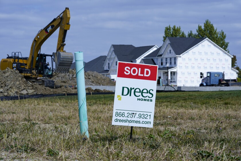 "A ""sold"" sign sits on a lot as new home construction continues in Westfield, Ind., Friday, Sept. 25, 2020. U.S. home construction rose a solid 1.9% in September after having fallen in August as home building remains one of the bright spots for the economy. (AP Photo/Michael Conroy)"