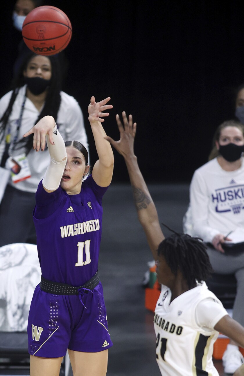 Washington forward Haley Van Dyke (11) shoots as Colorado guard Mya Hollingshed (21) defends during an NCAA college basketball game in the first round of the Pac-12 women's tournament Wednesday, March 3, 2021, in Las Vegas. (AP Photo/Isaac Brekken)