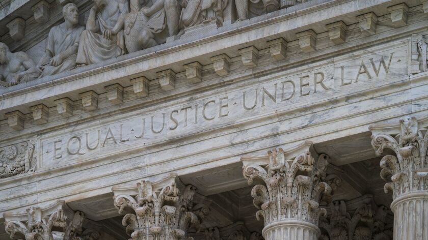 """The west facade of the Supreme Court Building bears the motto """"Equal Justice Under Law,"""" in Washingt"""