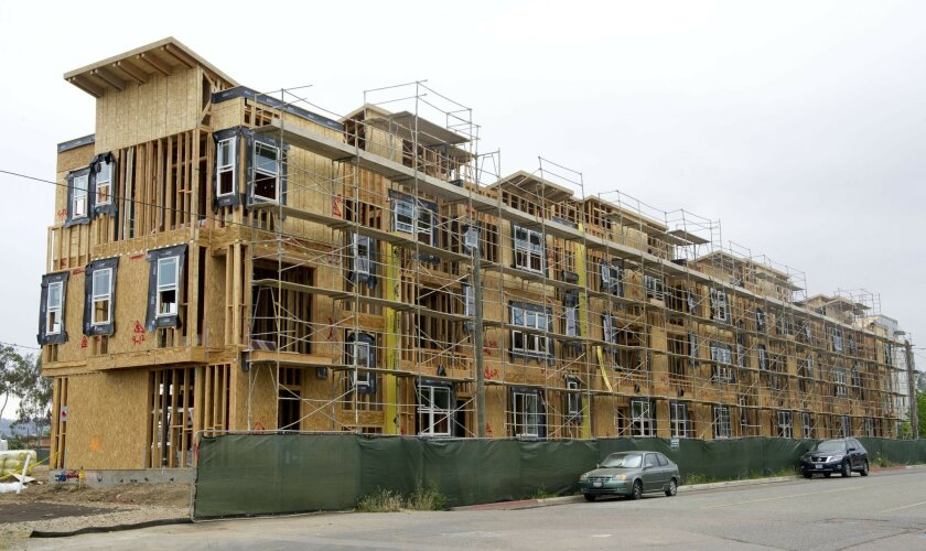 Construction on the Contempo condominium complex continues in downtown Escondido. The downtown area's first major condo complex will have 102 units and is expected to be complete by late June. Andy Wilhelm • U-T