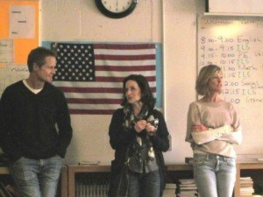 From left, Steve Kerr, Golden State Warriors head coach; Kay Gurtin, the site manager, and Teen Services Adolescent Book Group volunteer Nora Kaiser.