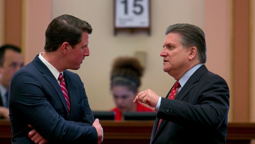 State Sens. Henry Stern (D-Canoga Park), left, and Robert Hertzberg (D-Van Nuys) confer before the Senate takes up California's budget plan on Thursday, the constitutional deadline for approving a 2017-18 spending plan.