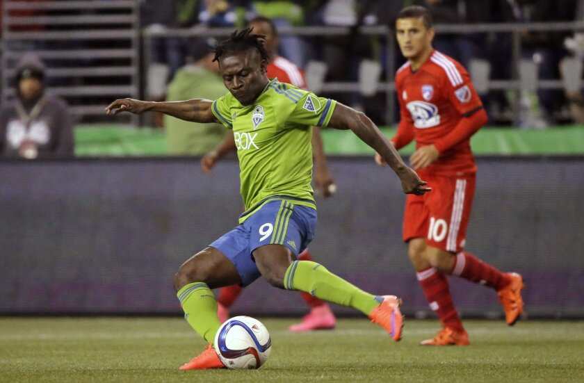 Seattle Sounders forward Obafemi Martins (9) kicks the ball against FC Dallas in the first half of an MLS soccer western conference semifinal playoff match, Sunday, Nov. 1, 2015, in Seattle. (AP Photo/Ted S. Warren)