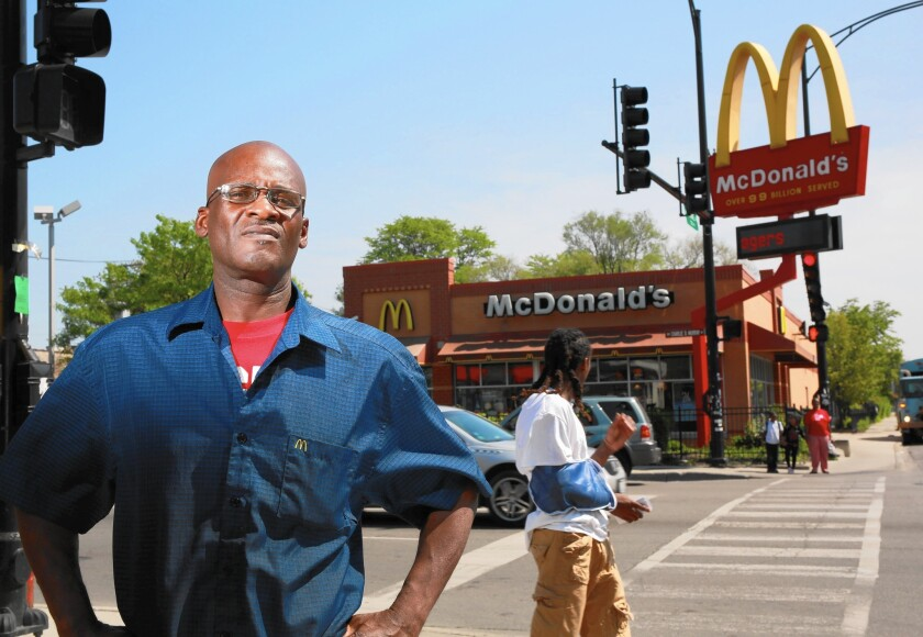 Douglas Hunter, 53, works at this McDonald's restaurant in Chicago. Hunter appeared on a poster for the Fight for $15, a campaign to increase minimum wage for fast-food workers.
