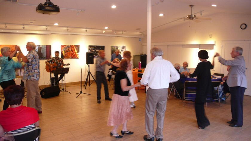 La Jolla Community Center guests dance to music by Ossie Arciniega and his trio.