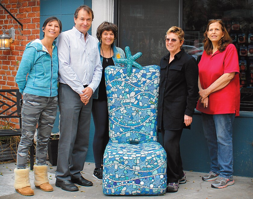 Bird Rock residents Tiffany Chow, John Newsam, Jane Wheeler, Barbara Dunbar and Lenise Delavar pose alongside the Bird Rock Community Council's 2019 '25th Anniversary Chair,' which now sits in front of All About Animals pet store, 5622 La Jolla Blvd.