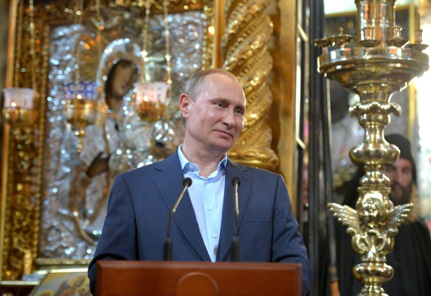 Russian President Vladimir Putin visits the Russian monastery St. Panteleimon at Karyes, on Mount Athos, Greece, Saturday, May 28, 2016. Russian President Vladimir Putin visited an Orthodox Christian monastery on the northern Greek peninsula of Mount Athos on Saturday, a sacred place that is off-li