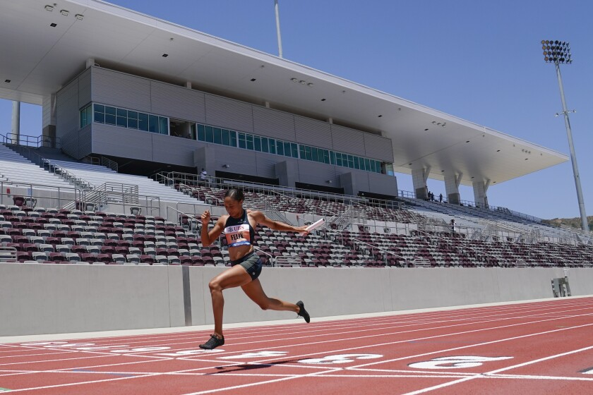 Allyson Felix crosses the finish line of the women's 3x100m relay at the Weltklasse Zürich Inspiration Games at Mt. San Antonio College on Thursday, July 9, 2020, in Walnut, Calif. Athletes competed from seven different locations around the world. (AP Photo/Ashley Landis)