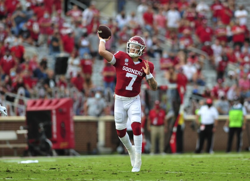 Oklahoma quarterback Spencer Rattler throws a pass against Missouri State during an NCAA college football game Saturday, Sept. 12, 2020, in Norman, Okla. (Kyle Phillips/The Norman Transcript via AP)